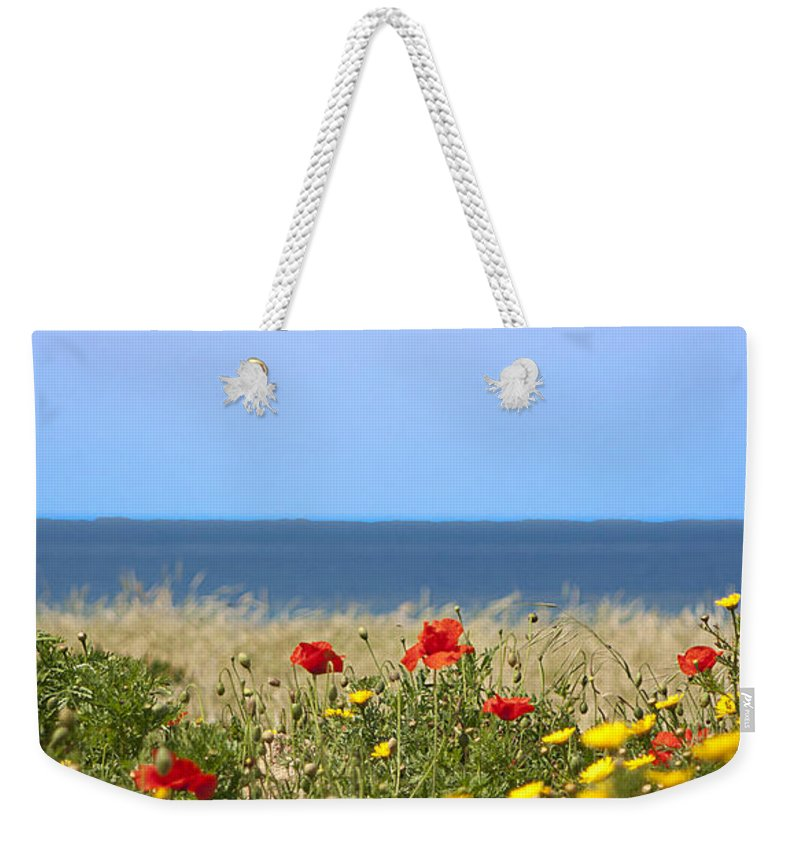 Red Weekender Tote Bag featuring the photograph Cyprus Poppies by Peter Lloyd