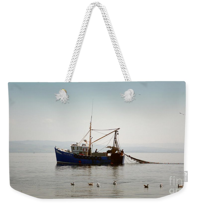 Boat Weekender Tote Bag featuring the photograph Daily Catch by Lynn Bolt