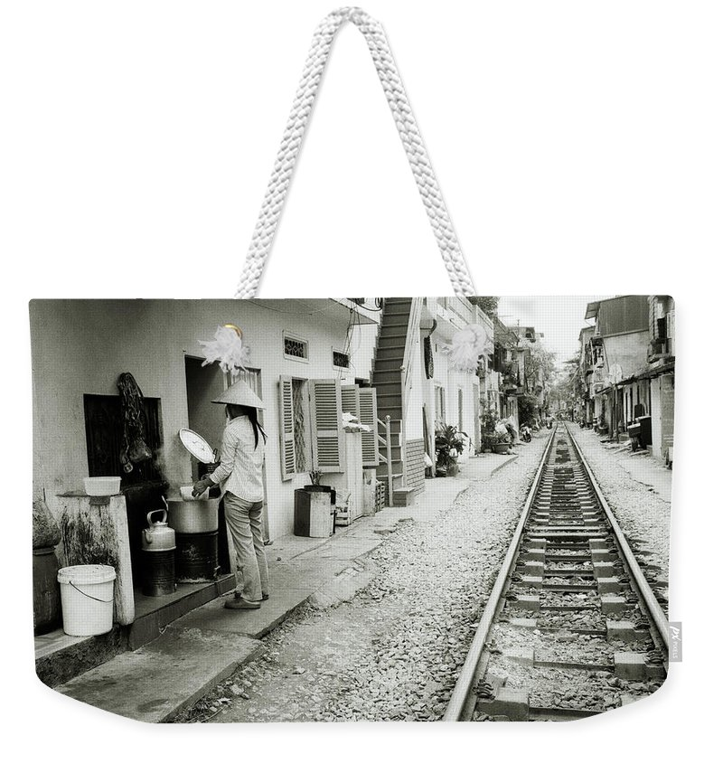 Asia Weekender Tote Bag featuring the photograph Daily Life In Hanoi by Shaun Higson