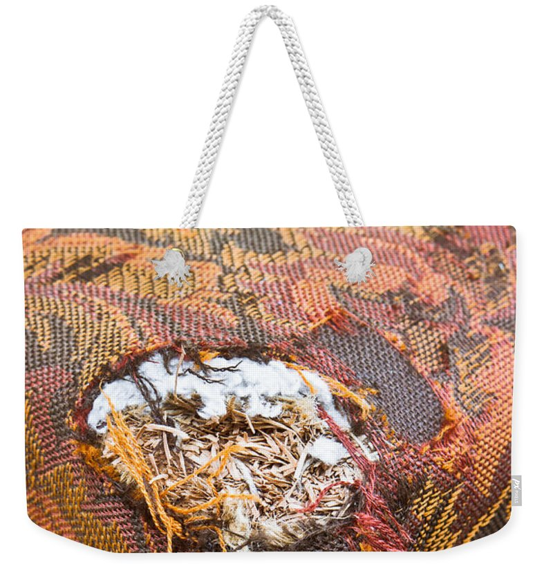 Accidental Damage Weekender Tote Bag featuring the photograph Damaged Upholstery by Tom Gowanlock