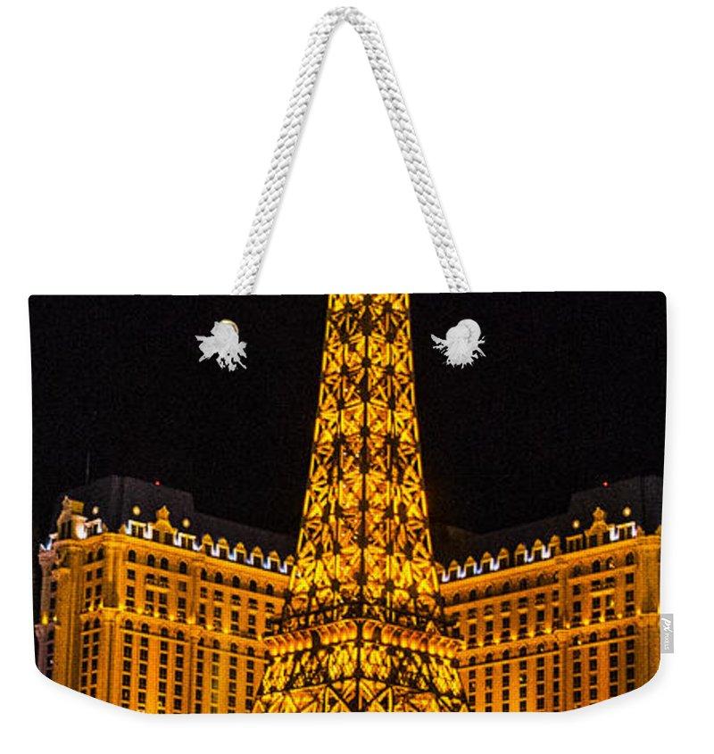 Las Vegas Weekender Tote Bag featuring the photograph Dancing Waters In Paris by Angus Hooper Iii