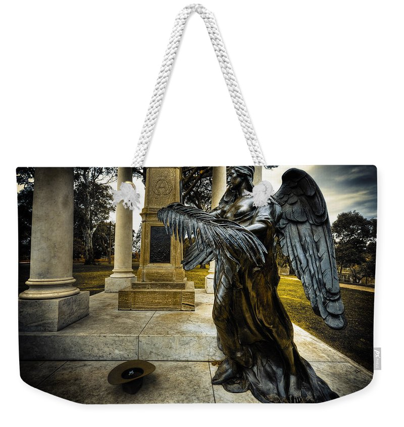 Angel Weekender Tote Bag featuring the photograph Dark Angel by Wayne Sherriff