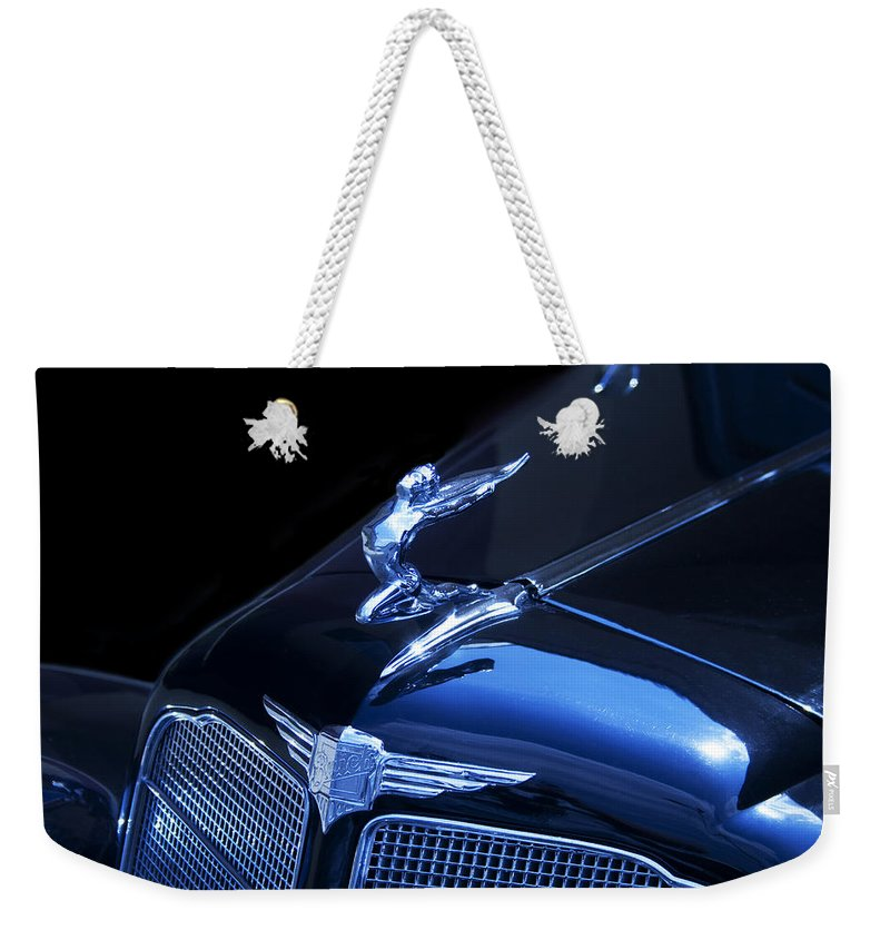 Winged Weekender Tote Bag featuring the photograph Dark Blue Classic Buick Flying Lady Hood Ornament by Kathy Clark