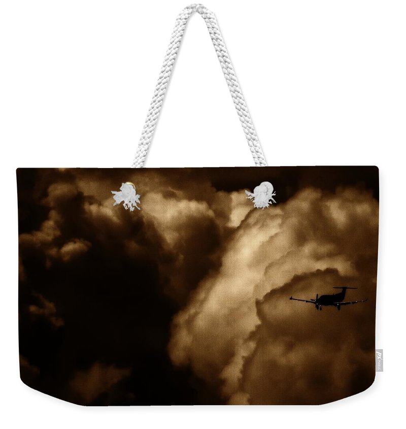 Pilatus Pc 12 Weekender Tote Bag featuring the photograph Dark Clouds by Paul Job