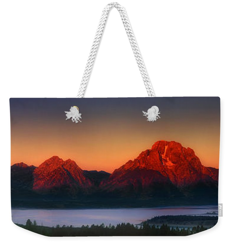 Wyoming Landscape Weekender Tote Bag featuring the photograph Dawn Light On The Tetons Grant Tetons National Park Wyoming by Dave Welling