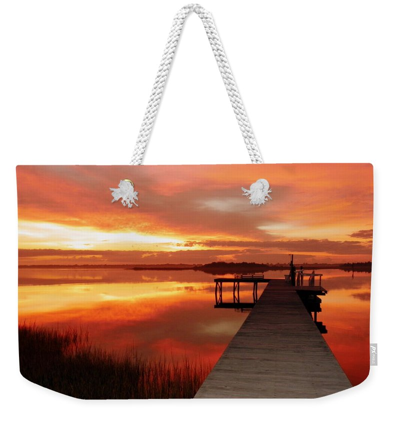 Orange Waterscapes Weekender Tote Bag featuring the photograph Dawn Of New Year by Karen Wiles