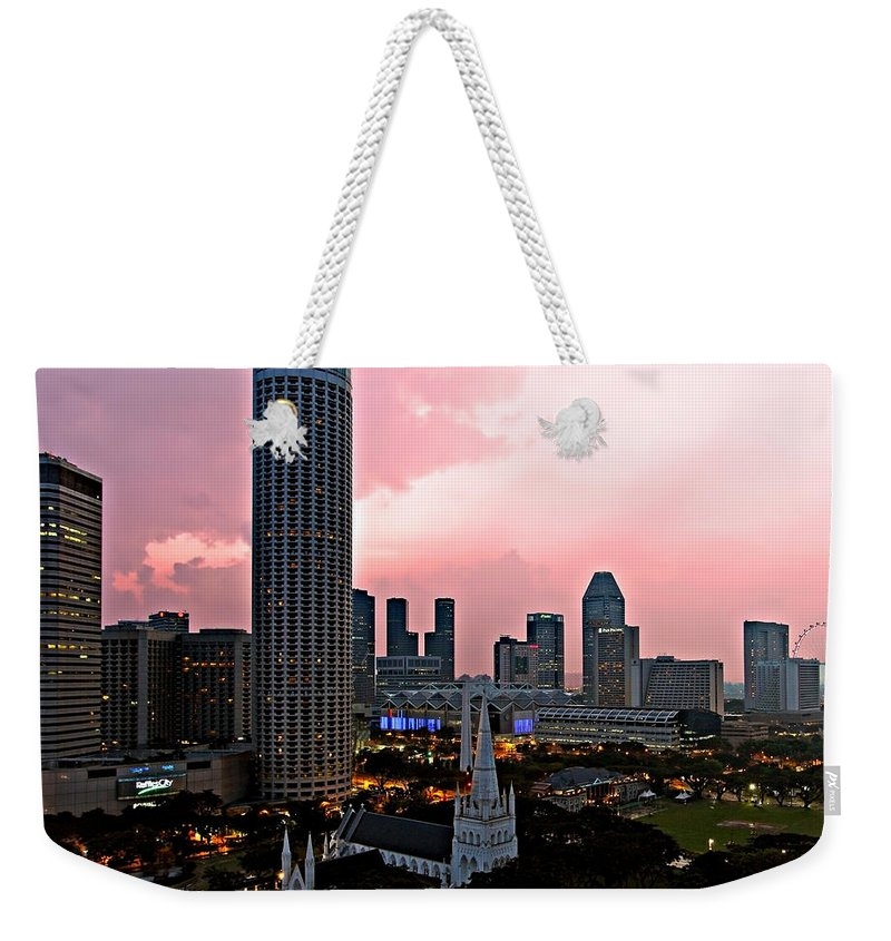 Singapore Weekender Tote Bag featuring the photograph Dawn Over Singapore by Paul Fell