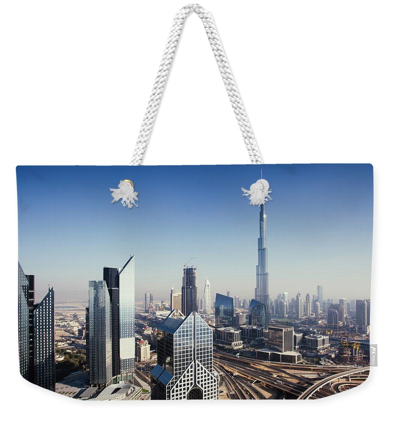 Downtown District Weekender Tote Bag featuring the photograph Dbuai Sky Line With Traffic Junction by Tempura