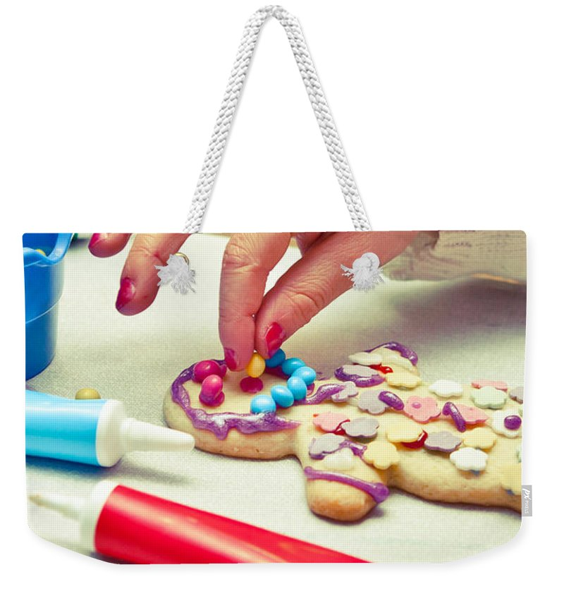 Art Weekender Tote Bag featuring the photograph Decorating Gingerbread Man by Tom Gowanlock