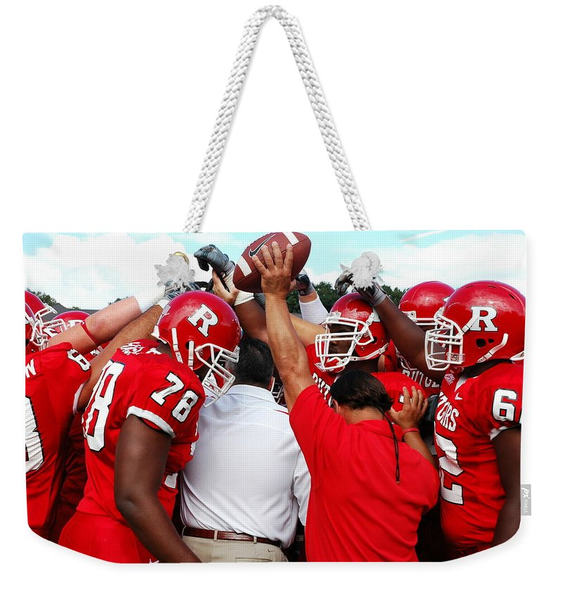 Rutgers Weekender Tote Bag featuring the photograph Defensive Huddle by Allen Beatty