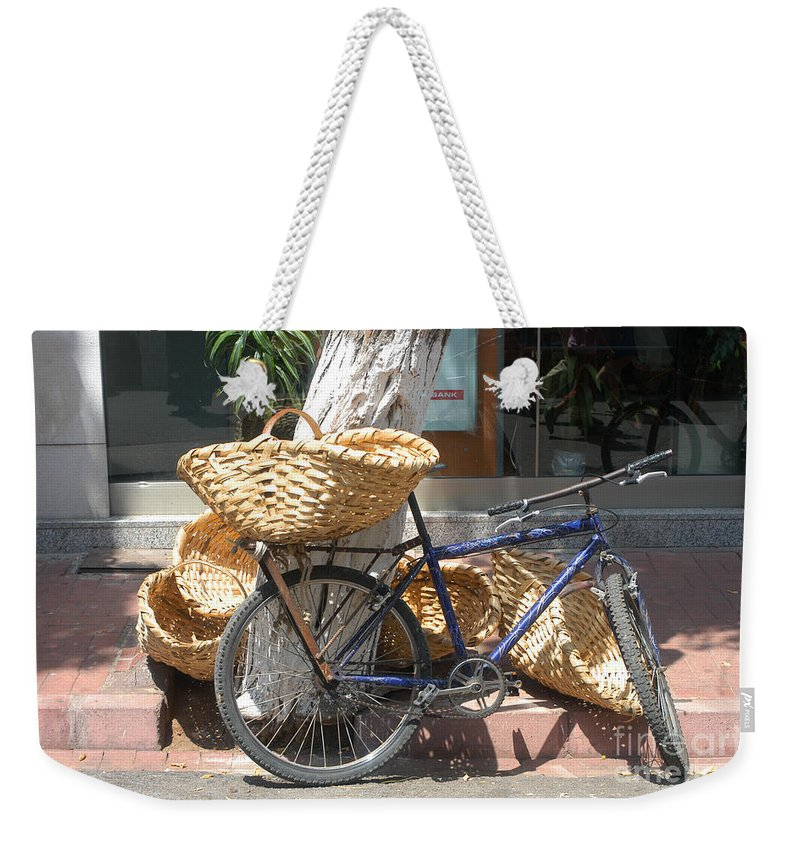 Büyükada Buyukada Island Istanbul Turkey Basket Baskets City Cities Cityscape Cityscapes Islands Bike Bikes Bicycle Bicycles Store Stores Odds And Ends Weekender Tote Bag featuring the photograph Delivery Bike by Bob Phillips