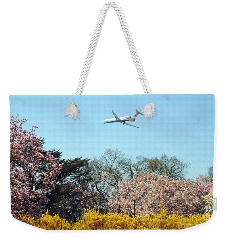 Delta Weekender Tote Bag featuring the photograph Delta Airlines by Jost Houk