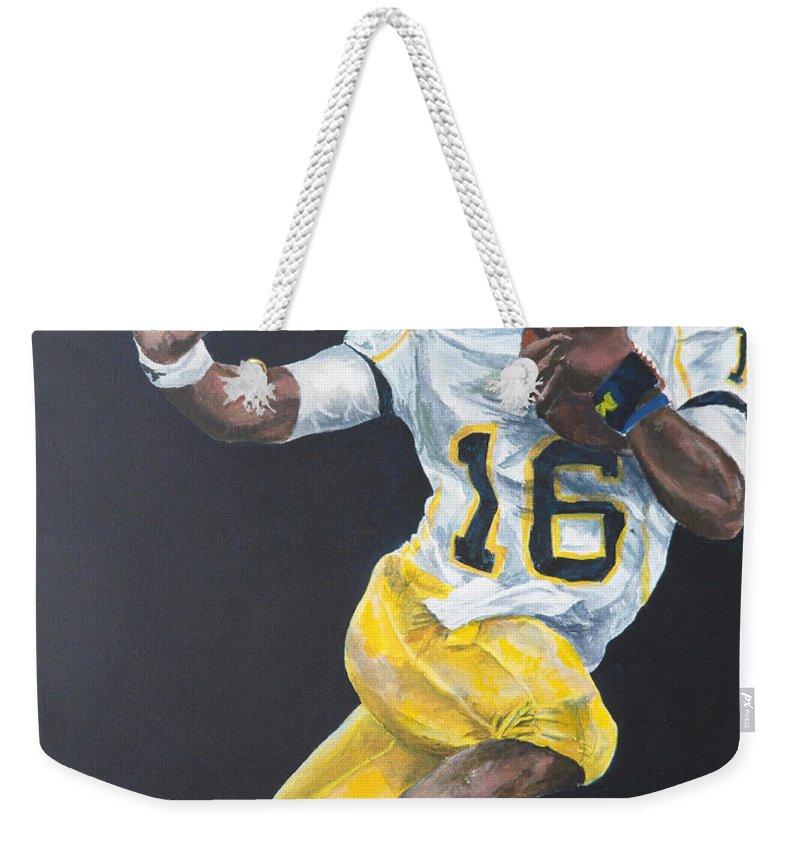 Denard Robinson Weekender Tote Bag featuring the painting Denard Heisman by Travis Day