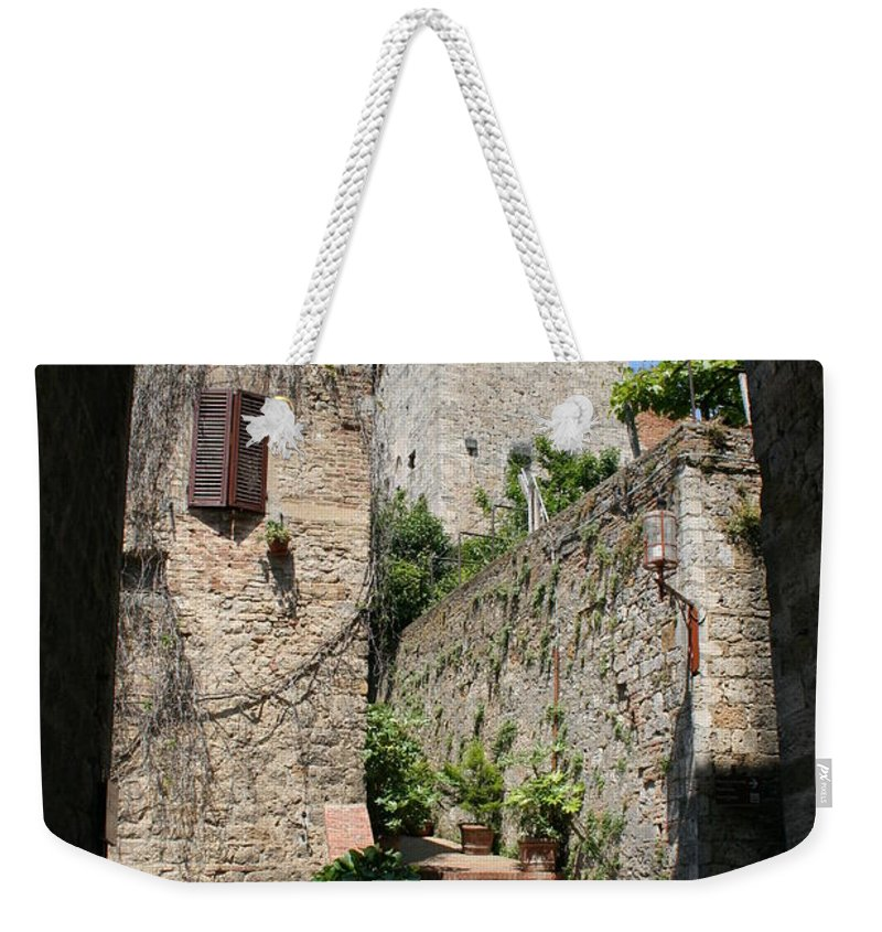 Way Weekender Tote Bag featuring the photograph Desert Alley In San Gimignano by Christiane Schulze Art And Photography