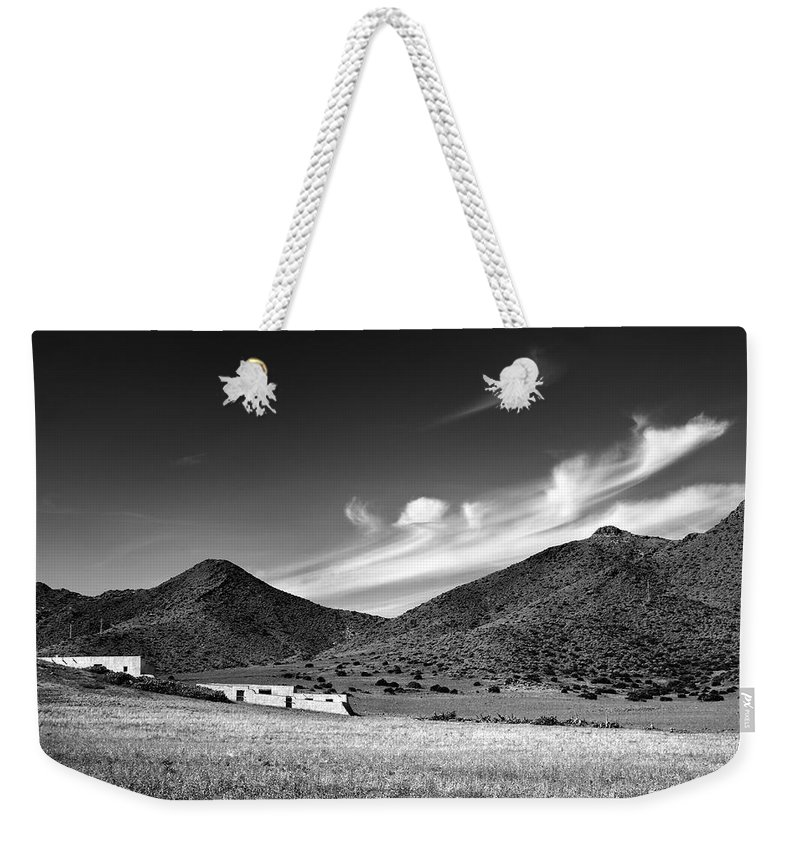 Monocronme Weekender Tote Bag featuring the photograph Desert Clouds by Guido Montanes Castillo