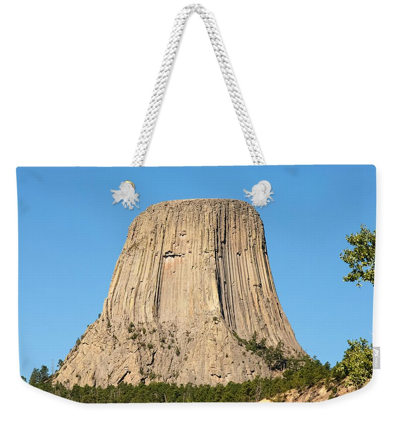 Nature Weekender Tote Bag featuring the photograph Devils Tower by John M Bailey