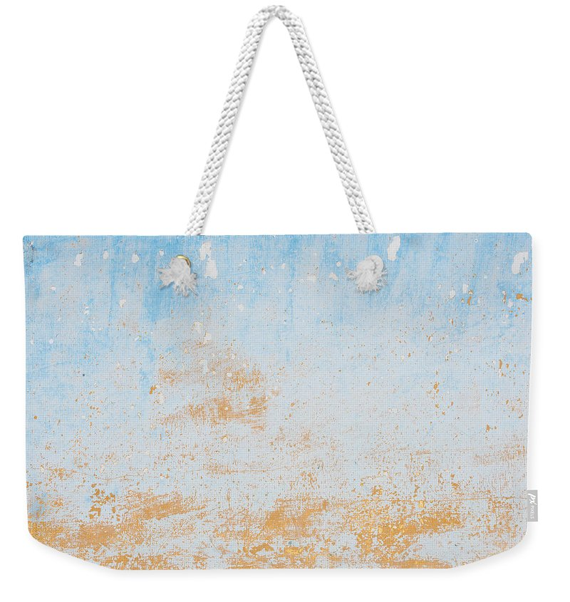 Blue Weekender Tote Bag featuring the photograph Dilapidated Beige And Blue Wall Texture by Dutourdumonde Photography