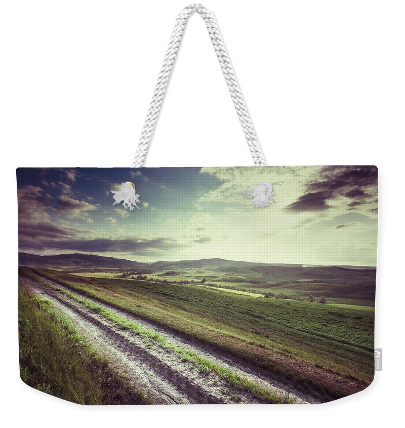 Steppe Weekender Tote Bag featuring the photograph Dirt Track In Tuscany by Xavierarnau
