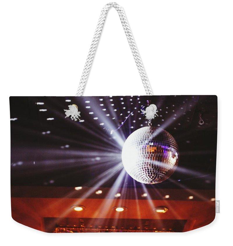 Hanging Weekender Tote Bag featuring the photograph Disco Ball At Illuminated Nightclub by Shaun Wang / Eyeem