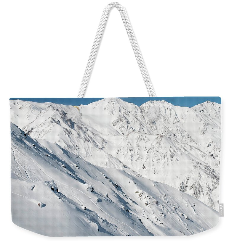 Color Image Weekender Tote Bag featuring the photograph Distant View Of Sandra Hillen by Brandon Huttenlocher