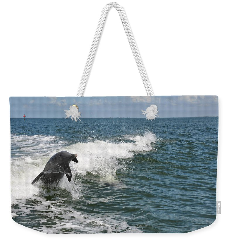 Animal Weekender Tote Bag featuring the photograph Dolphin In Waves by Deborah Good