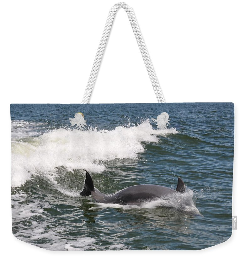 Animal Weekender Tote Bag featuring the photograph Dolphin Surf by Deborah Good