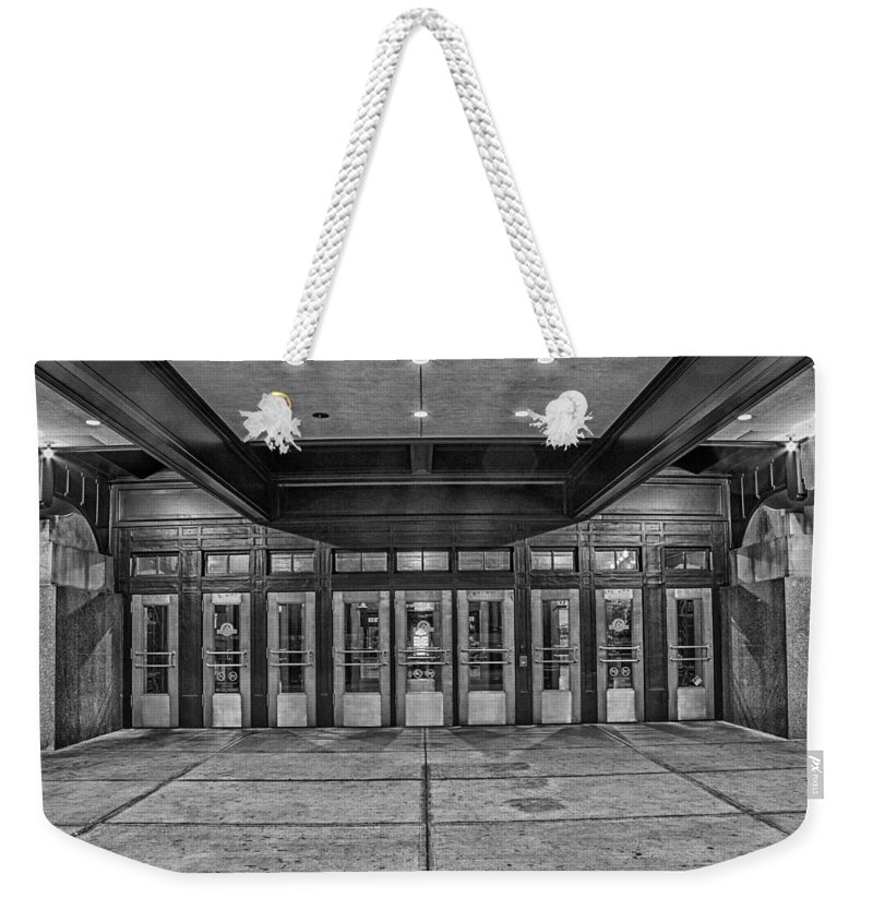 Union Station Weekender Tote Bag featuring the photograph Doors by Ken Kobe