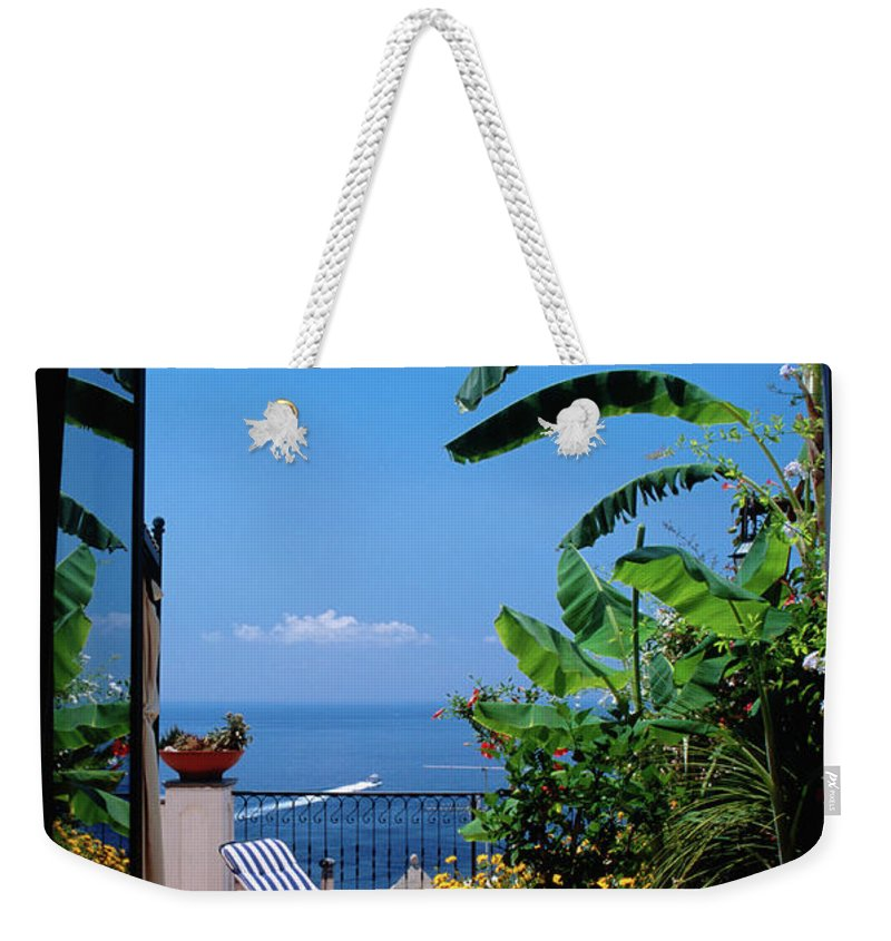 Tranquility Weekender Tote Bag featuring the photograph Doorway To Terrace At Hotel Punta by Dallas Stribley