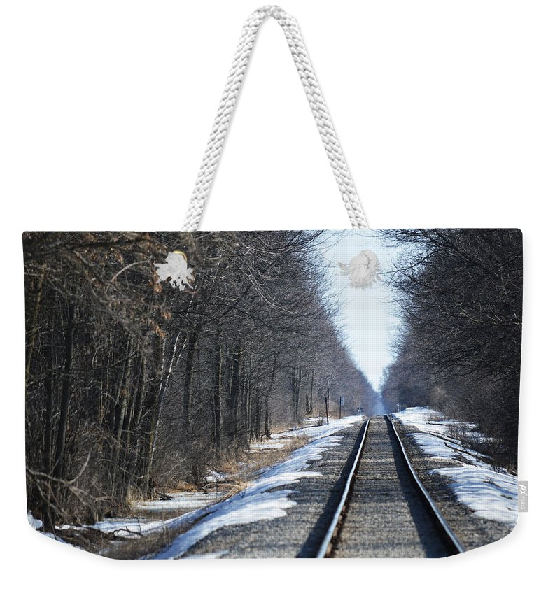 Rosebush Weekender Tote Bag featuring the photograph Down The Rails by Linda Kerkau