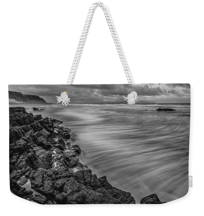 Ireland Weekender Tote Bag featuring the photograph Downhill Waves by Nigel R Bell