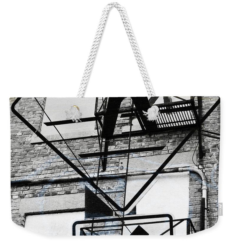 Downtown Weekender Tote Bag featuring the photograph Downstairs by The Artist Project