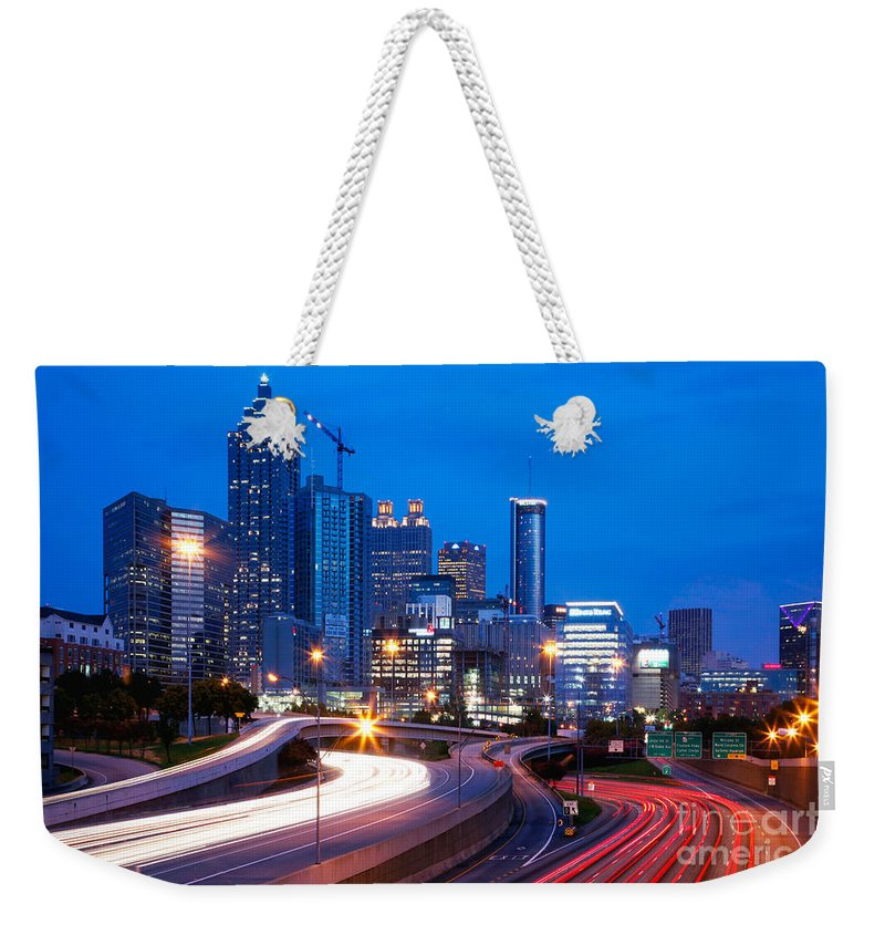 I-75 Weekender Tote Bag featuring the photograph Downtown Atlanta At Dusk by Bill Cobb