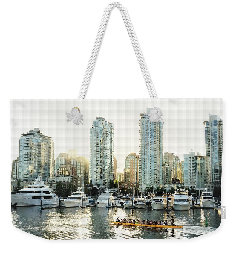 Tranquility Weekender Tote Bag featuring the photograph Dragon Boating In Vancouver by Carlina Teteris