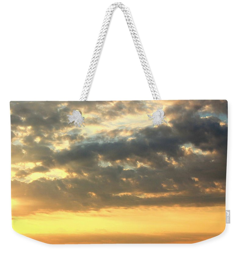 Clouds Weekender Tote Bag featuring the photograph Dramatic Sunglow by Deborah Crew-Johnson