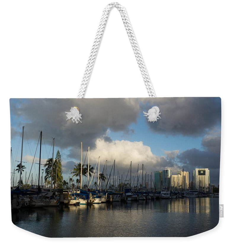 Dramatic Tropical Storm Weekender Tote Bag featuring the photograph Dramatic Tropical Storm Light Over Honolulu Hawaii by Georgia Mizuleva
