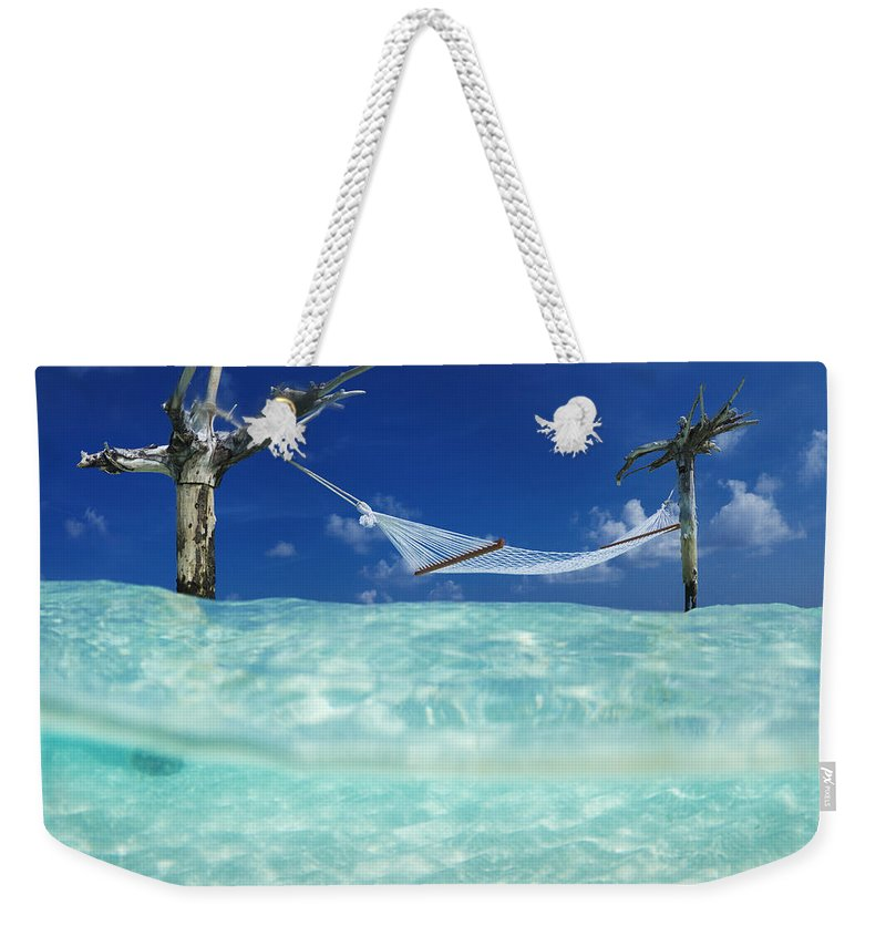 Tropical Weekender Tote Bag featuring the photograph Dream Hammock. by Sean Davey