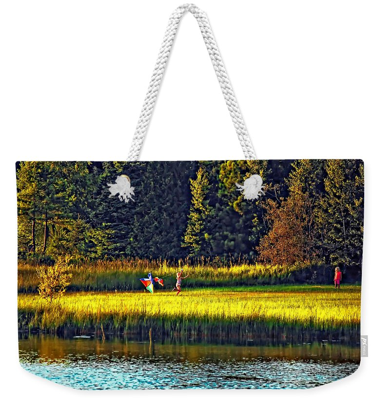 Kids Weekender Tote Bag featuring the photograph Dreams Can Fly by Steve Harrington
