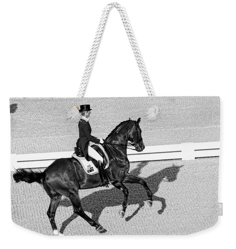 Dressage Weekender Tote Bag featuring the photograph Dressage Une Noir by Alice Gipson