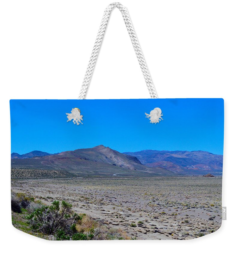 Rock Weekender Tote Bag featuring the photograph Dried Lake Beach by Brent Dolliver