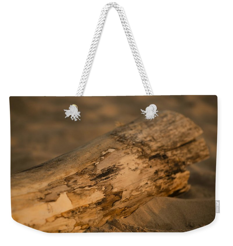 Michigan Weekender Tote Bag featuring the photograph Driftwood by Sebastian Musial