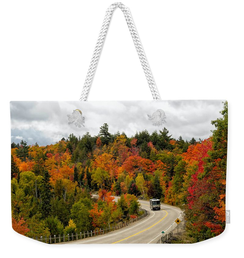 Algonquin Weekender Tote Bag featuring the photograph Driving Through Algonquin Park In Fall by Les Palenik