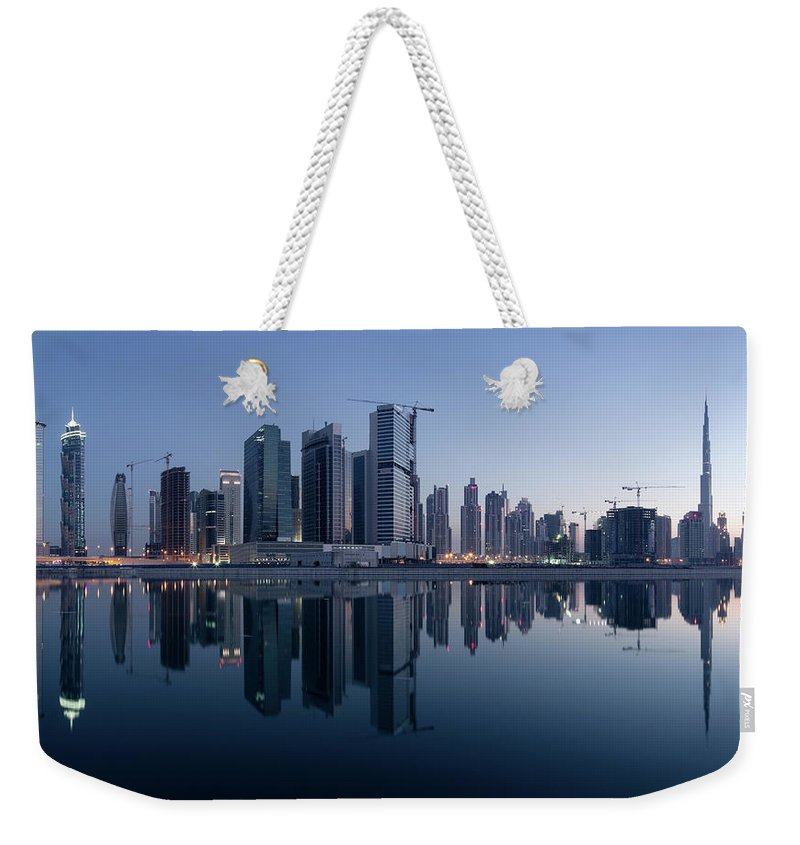 Tranquility Weekender Tote Bag featuring the photograph Dubai Business Bay Skyline With by Spreephoto.de