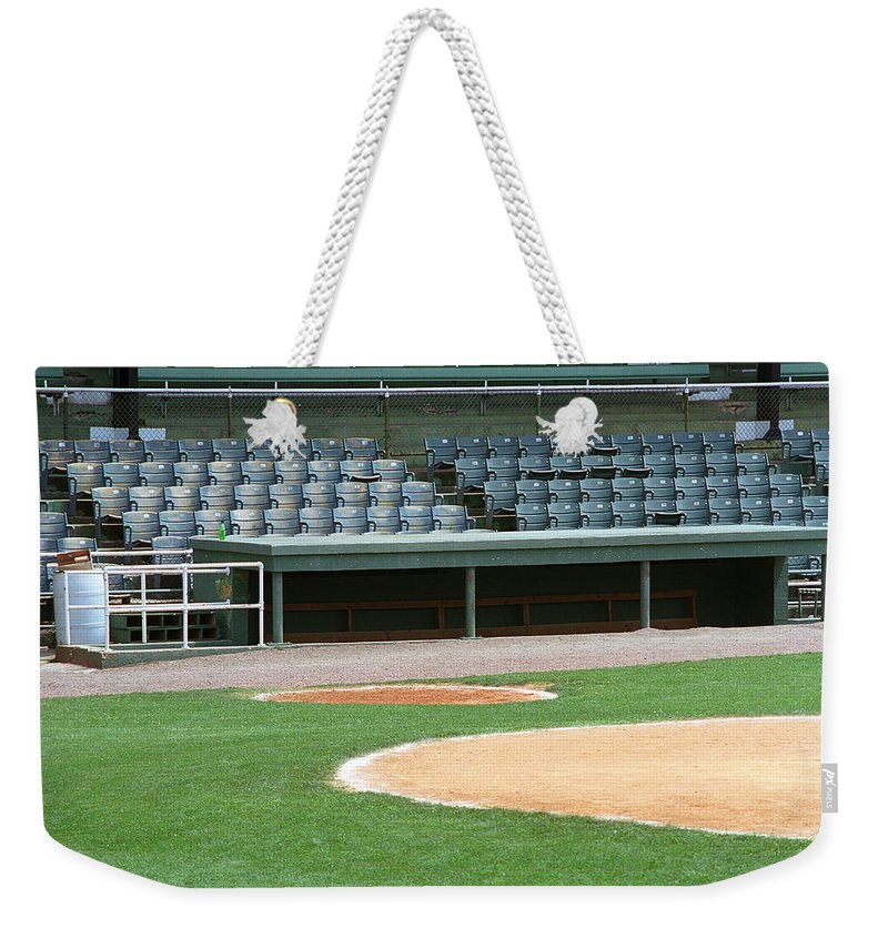 Aisles Weekender Tote Bag featuring the photograph Dugout At The Old Ballpark by Frank Romeo