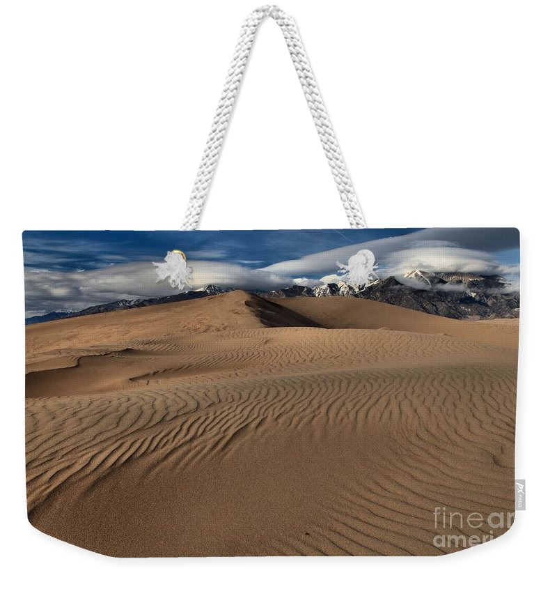 Great Sand Dunes National Park Weekender Tote Bag featuring the photograph Dunes Ripples And Clouds by Adam Jewell