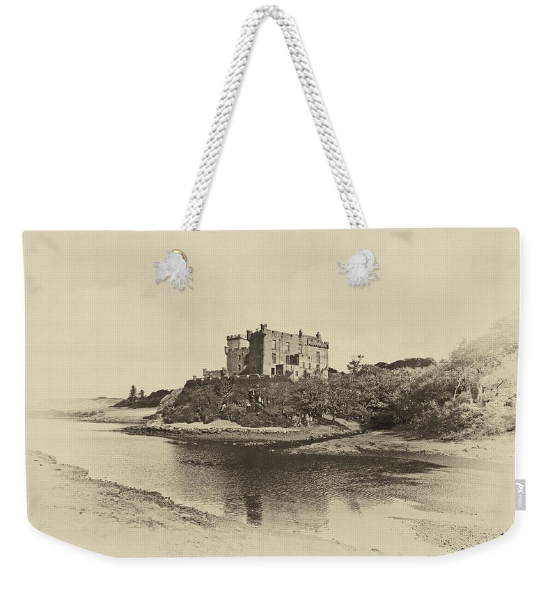 Ancient Weekender Tote Bag featuring the photograph Dunvegan Castle by Chris Thaxter