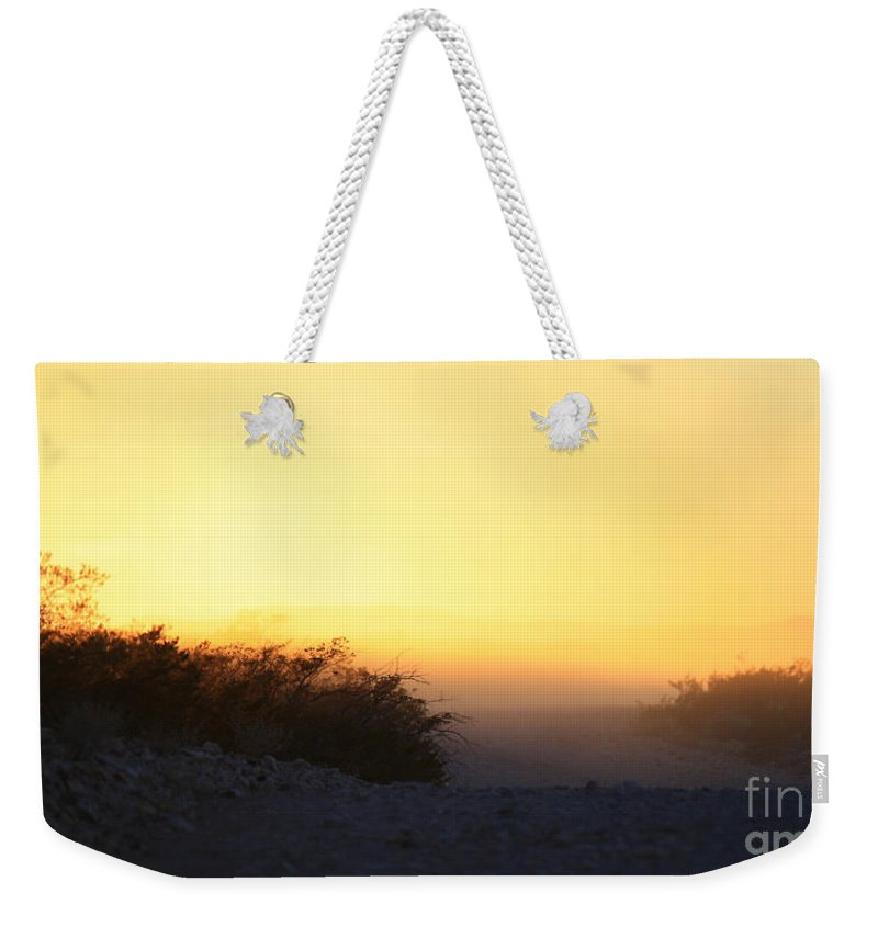 Roena King Weekender Tote Bag featuring the photograph Dusty Sunset Road by Roena King