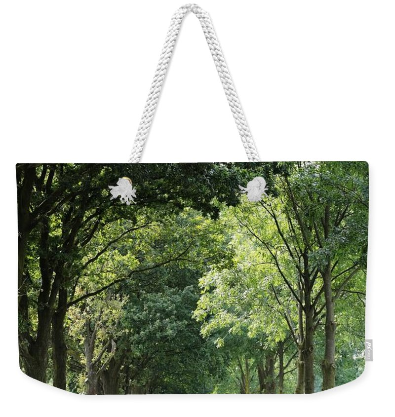 Holland Weekender Tote Bag featuring the photograph Dutch Landscape - Country Road by Carol Groenen