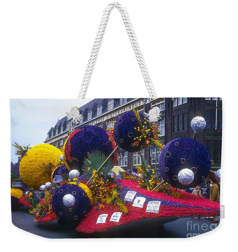 Tulip Parade Weekender Tote Bag featuring the photograph Dutch Tulip Parade by Bob Phillips