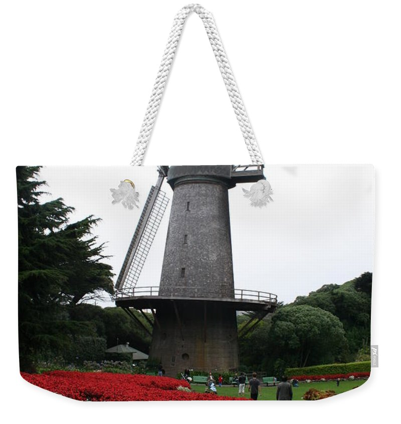 San Francisco Weekender Tote Bag featuring the photograph Dutch Windmill In Golden Gate Park by Christiane Schulze Art And Photography