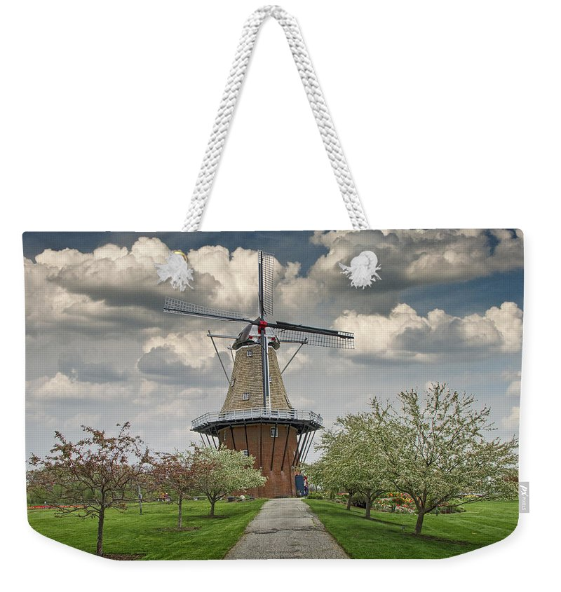 Art Weekender Tote Bag featuring the photograph Dutch Windmill The Dezwaan On Windmill Island In Holland Michigan by Randall Nyhof